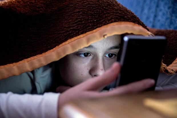 The truth is that kids are growing up with technology, and it's having a huge impact on their mental health. Stock picture posed by model. Credit: Getty Images