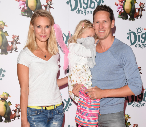 Brendan Cole and wife Zoe Hobbs and with their daughter Aurelia