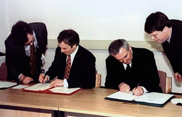 Tony Blair (second left) and Bertie Ahern signed the Good Friday Agreement in 1998