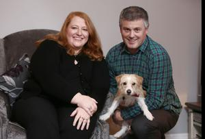 Shared values: Naomi at home with her husband Michael and dog Daisy in Belfast