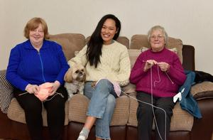 Yuri Lee Keown with knitters Elizabeth Graham and Esther Spiers in Kilkeel