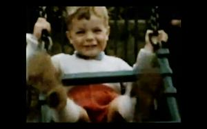 David on a swing as a young boy