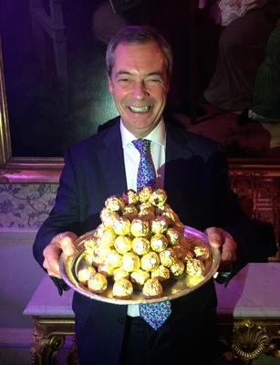Golden moment: Nigel Farage is presented with a tray of Ferrero Rocher at the Ritz
