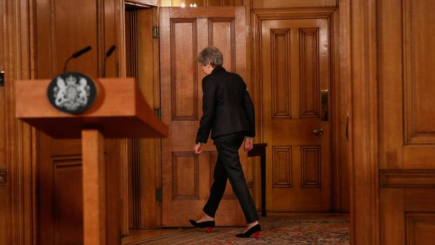Theresa May trudging off after her speech