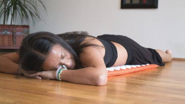 Multi-use: women use Shakti mats for meditation, pain relief and exercise