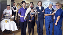 Labour of love: head chef Sam, porter Alessandro, midwife Annabel, new mother Hui with baby Lucas, CEO Janene, and consultants Joseph and Penny in The Portland Hospital