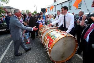 Hand of friendship: The Prince of Wales meets members of the Orange Order at the Museum of Orange Heritage at Sloan's House during his visit to Loughgall this week