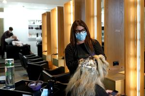A woman at the hairdressers after lockdown