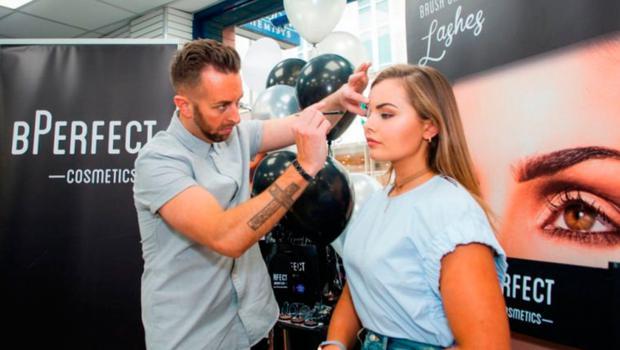 Brendan McDowell giving former Miss Northern Ireland Tiffany Brien the beauty treatment