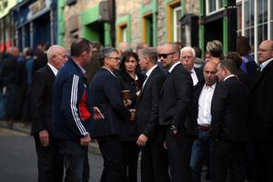 Sad farewell: Ulster coach Les Kiss (third left) at Anthony's funeral