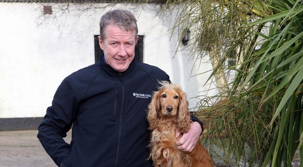 Chris Hanlon and his dog Tilly, who gave birth to 11 puppies recently
