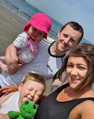 Keira McCambridge with her partner Sean and children Connor and Faye
