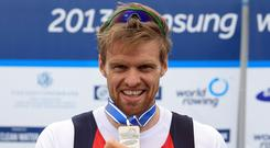 Alan with silver medal he won in men's single sculls final at the 2013 Samsung World Rowing Cup II