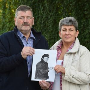 Tragic story: David Kerrigan and wife Irene with a photograph of David's sister Heather who was murdered by the IRA