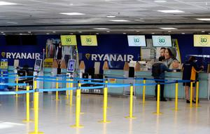 Different world: an empty Ryanair check-in desk in Terminal 1 at Dublin airport