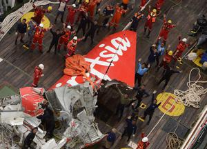 Part of AirAsia flight QZ8501 is lifted onto a Crest Onyx ship
