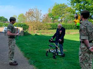 With members of the 1st Battalion The Yorkshire Regiment forming a guard of honour as the veteran completed the 100th length of his garden at his home in Bedfordshire
