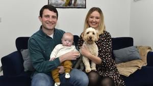 Happy outlook: Peter Bradley at his Carryduff home with wife Lisa and three-month-old baby Fin and dog Lola