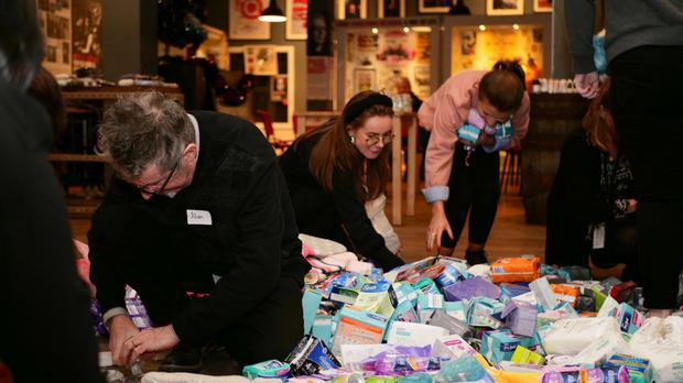 Team effort: volunteers putting together period packs at The Homeless Period Belfast