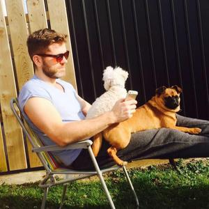Furry friends: Vinny Hurrell with his dogs Teenie and Thor