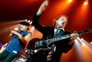 Guitarist Angus Young of hard rock band AC/DC