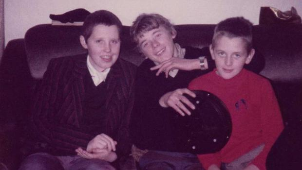 John (centre), with his brother Francis (right) and a friend