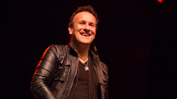 Vivian Campbell performs on stage with his band Last in Line