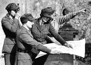 Handy outfits: Women's Transport Service members (Northern Ireland Section) wearing utilitarian uniforms in 1939