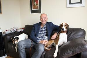 Zoran relaxes at his home just outside Comber with his dogs