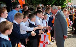 Prince Charles being greeted by well-wishers and during a visit to the Orange Order heritage museum in Loughgall