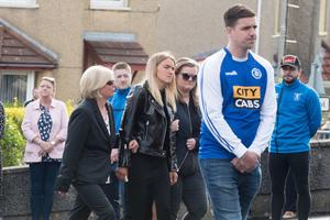 Bronagh at the funeral of Thomas who played for Trojans football team