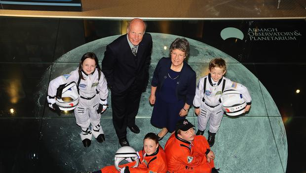 Professor Michael Burton, director of Armagh Planetarium, and astrophysicist Dame Jocelyn Bell Burnell celebrate the 50th anniversary of the planetarium with local 'astronauts' Alanna Gray, Molly Monaghan, Jack Wilson and Ruben Finlay