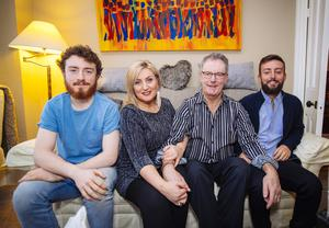 Mike's siMike and Lynda Bryans at home with their sons Chris (left) and Peter