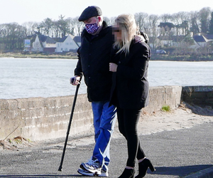 Posed pictures: Michael Stone and wife Karan walking by the sea