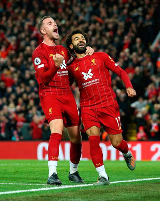 Mo Salah (right) celebrates with Liverpool captain Jordan Henderson after scoring in a game last October
