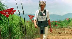Diana, Princess of Wales, walks in one of the safety corridors of the land mine field of Huambo