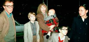 Bitter split: Woody Allen with his family in 1988 including (from left, Fletcher Previn, Mia Farrow (holding Dylan), Moses Farrow and Soon-Yi Previn
