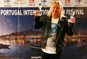 Double delight: Gavin Irvine with his awards for Best Short Film and Best Director at the Portugal International Film Festival