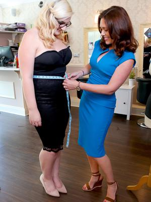 Measuring up: Clare Brown being fitted by Nicola Crawford for the corset