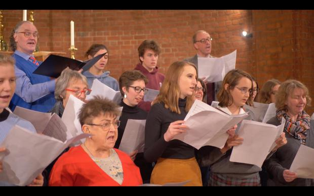 The choir performing Clare's piece