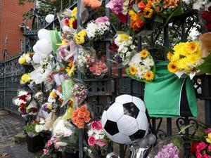 Flowers left on the gate of Saint Malachy's College