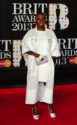 Laura in a long white coat at the Brit Awards in 2013