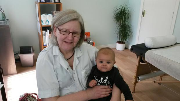 Healing hands: Fiona Jennings with a young patient