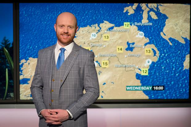 Barra in front of the cameras presenting a weather forecast