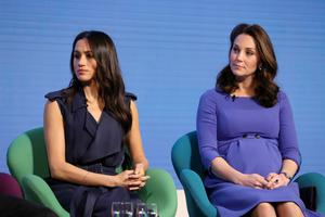 Trouble brewing: Meghan and Kate at an event earlier this year in London