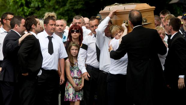 The remains of Seamus McKenna leaving St Mary's Church in Ravensdale, Co Louth