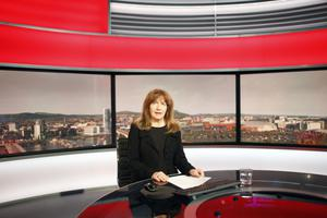 Mary in the studio at the BBC, where she signs the lunchtime news bulletin round-up
