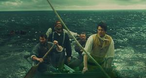 Deep trouble: Chris Hemsworth (right) and his crewmen face a harrowing battle for survival
