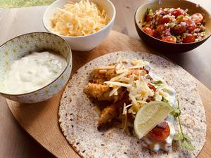 Tacos with crispy buttermilk chicken, sour cream, cheese and salsa