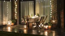 Ambient vibe: an outdoor patio with table and chairs, string lighting and lanterns